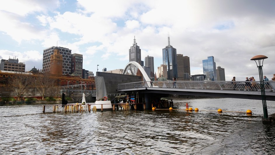The Yarra River overflows at Southbank and submerges a café in Melbourne, Australia