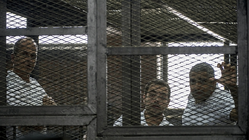 Peter Greste (L) and his two colleagues were each jailed for seven years