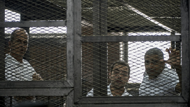 Peter Greste (L), Baher Mohamed (C) and  Mohamed Fadel Fahmy (R) were jailed yesterday