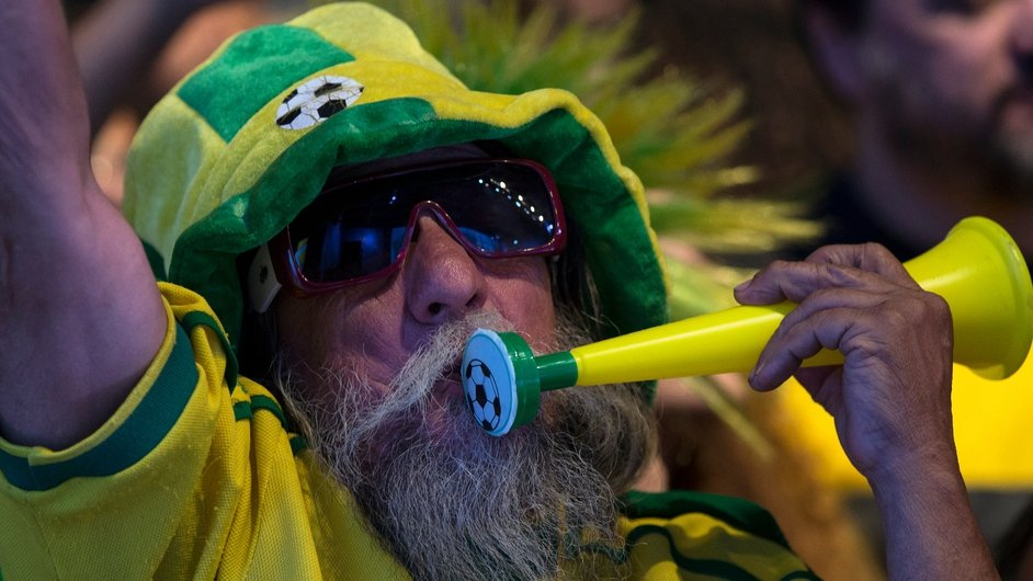 A fan of the Brazilian football team prepares to watch his team's World Cup match against Cameroon