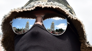 The Saint Sophia cathedral is reflected in the glasses of a new Ukrianian army volunteer recruit after a military oath ceremony in Kiev