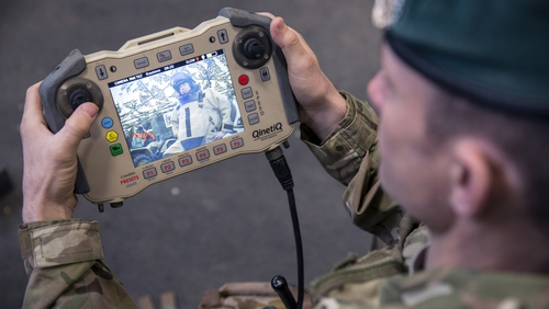 A soldier operates the control unit of a bomb disposal robot as part of a showcases of future specialist capabilities