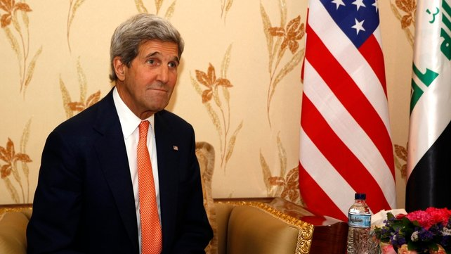 John Kerry urged Kurdish leaders to stand with Baghdad