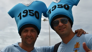 Uruguayan fans pose outside the Dunas Arena