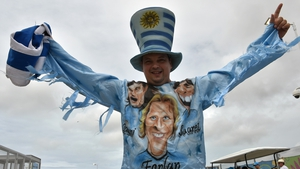 A Uruguay fan poses outside the Dunas Arena prior to a Group D football match between Italy and Uruguay in Natal