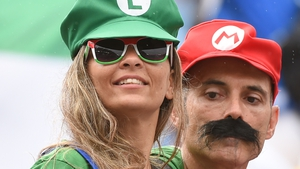 Italy fans show their support for Mario Balotelli by dressing up as Super Mario and Luigi prior to Italy v Uruguay