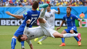 Diego Godin of Uruguay and Ciro Immobile of Italy compete for the ball