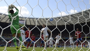 England's Ben Foster makes a fine save against Costa Rica...