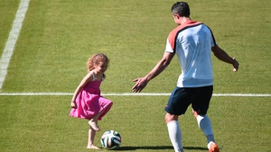 Elsewhere, Netherlands forward Robin van Persie plays with his daughter after a training session at the Flamengo Stadium