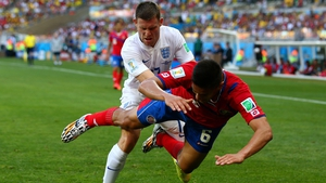 James Milner of England competes for the ball against Oscar Duarte of Costa Rica