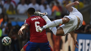 England defender Gary Cahill takes flight amid a challenge from Costa Rica's defender Oscar Duarte