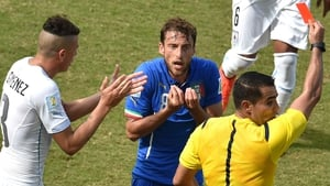 Italy's midfielder Claudio Marchisio reacts as he is shown a red card by Mexican referee Marco Antonio Rodriguez Moreno
