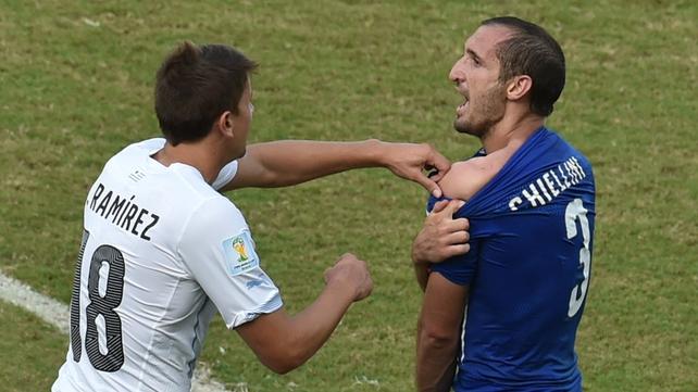 Uruguay's midfielder Gaston Ramirez  checks Chiellini's shoulder