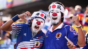 Japanese fans show their colours ahead of their side's game against Colombia