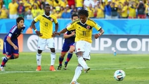Colombia's opening goal in stages: Juan Guillermo Cuadrado calmly slots the ball...
