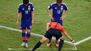 Japan's players toed the line, as determined by referee Pedro Proenca