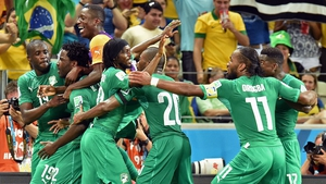 Wilfried Bony (second left) celebrates after scoring the crucial equaliser for Ivory Coast