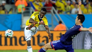 Colombia's Jackson Martinez scores during his team's group C preliminary round World Cup 2014 match against Japan