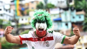 The Iranian hulk: A fan shows his colours ahead of Iran's last group game