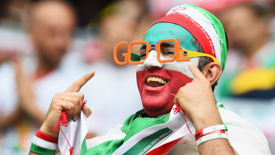 An Iranian fan shows an eye for goal (but seems to spell it wrongly, which kind of ruins the pun)