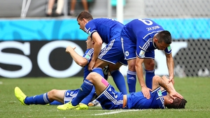 Muhamed Besic and Toni Sunjic are assisted by team-mates after a clash