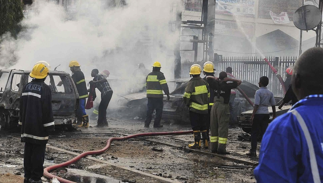 Emergency personnel at the scene of the blast in the Nigerian capital