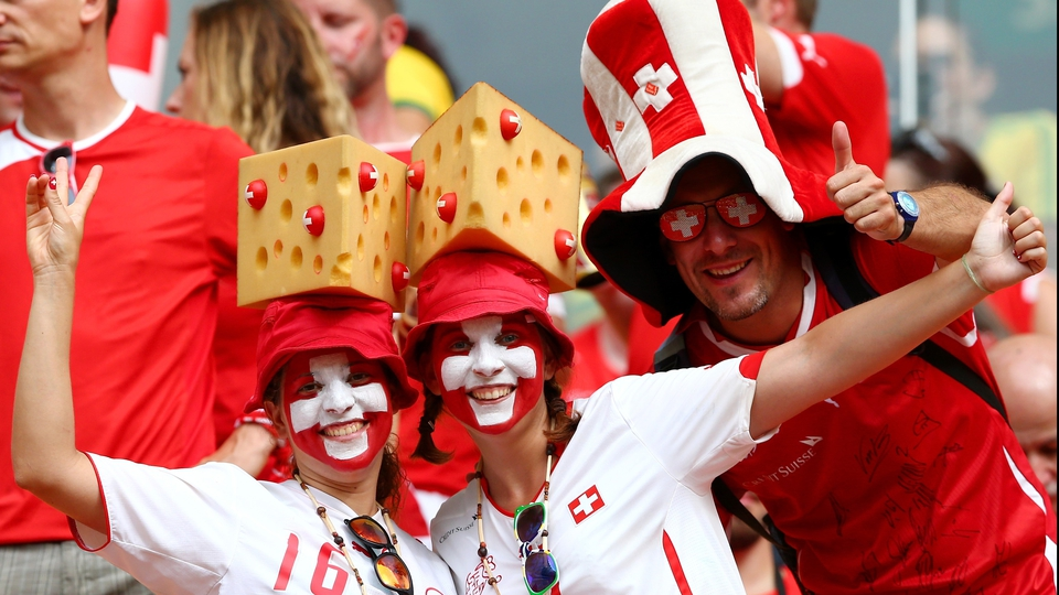 Obligatory shot of Swiss fans with Swiss cheese hats: check