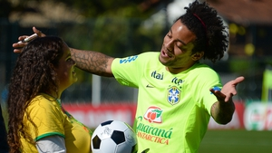 Meanwhile, elsewhere, Marcelo embraces a fan before a training session at Brazil's Granja Comary training complex