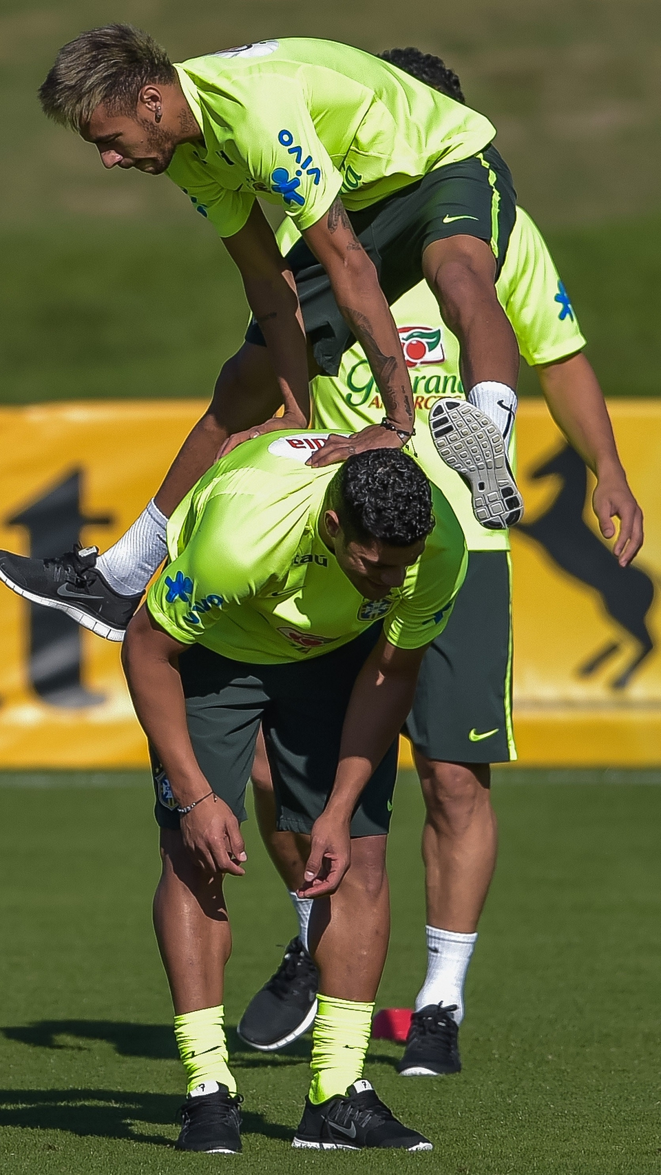 At the same training session, Neymar was in high spirits, leap-frogging Hulkl