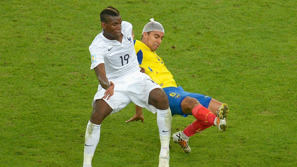 The bandaged Christian Noboa battles for the ball with Paul Pogba