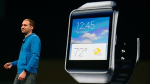 David Singleton, Director of Engineering of Android at Google, stands in front of a Samsung Gear Live