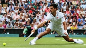 Serbia's Novak Djokovic stretches for the ball during his men's singles second round match on day three of the 2014 Wimbledon Championships