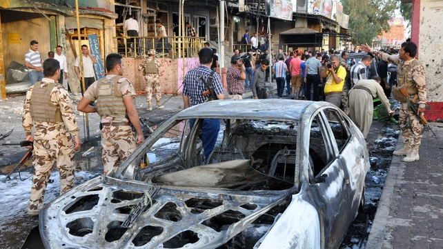 Iraqis gather at the site of a car bomb explosion in a Kurdish-majority neighbourhood of Kirkuk