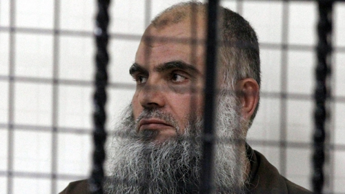 Abu Qatada behind bars at the state security court in Amman
