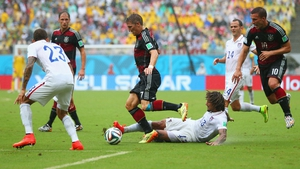 A Thomas Muller wonder-strike decided this game between Germany and USA but both teams progress