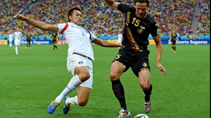 And South Korea forward Kim Shin-Wook challenged Belgium defender Daniel Van Buyten