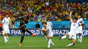 Belgium forward Divock Origi made a shot on goal later on...