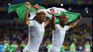 Players proudly ran with their flag after the match, which represented Algeria's first trip to a World Cup knockout stage in their history