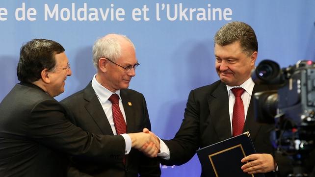 The EU's José Manuel Barroso, Herman Van Rompuy and Petro Poroshenko at the ceremony