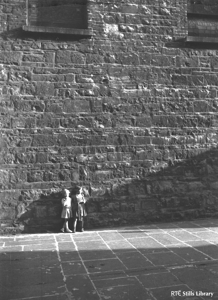 Children by high wall, Dublin