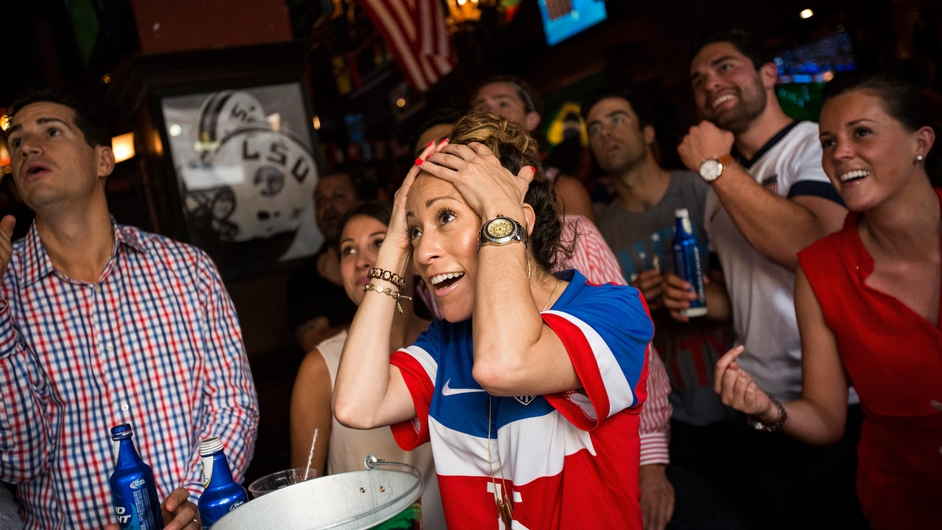 US fans watch their country's team take on Germany in the World Cup and celebrate their advance to the knock out round