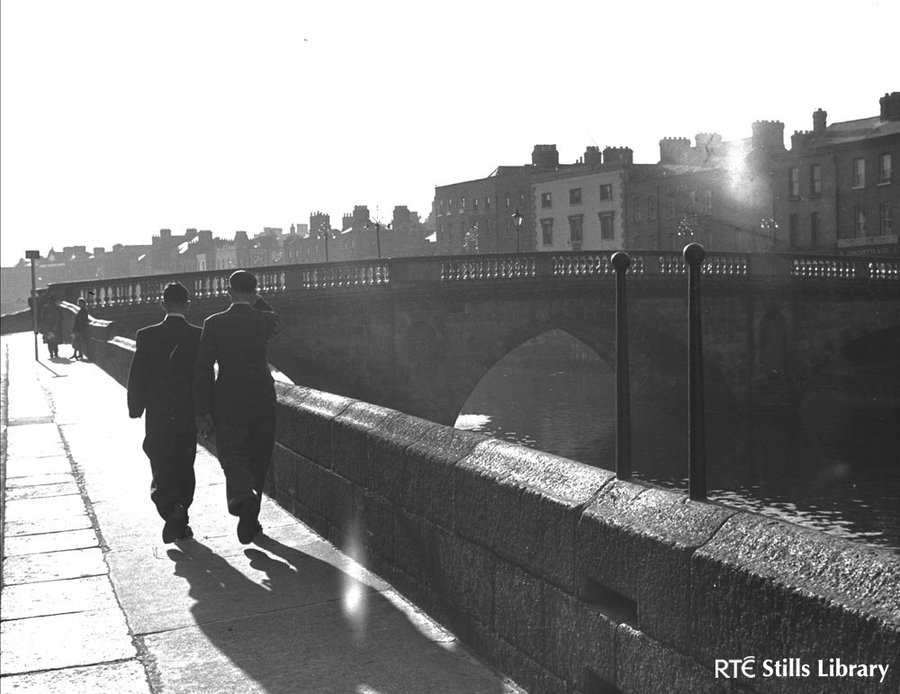 Men walk along liffey