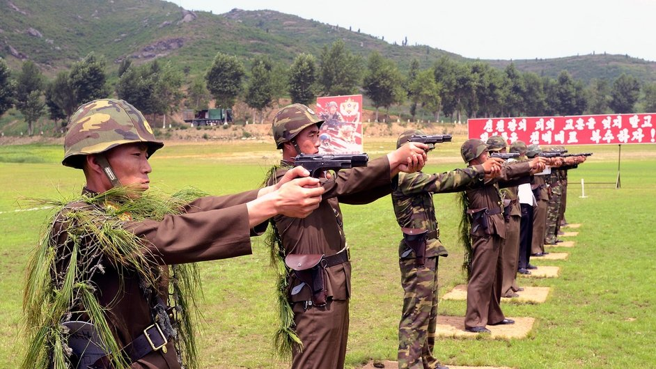 North Korean soldiers practice shooting during a ceremony before the graves of 400 mothers and 102 children in South Hwanghae Province