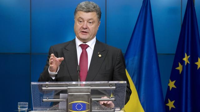 Petro Poroshenko yesterday signed a landmark free-trade deal at a European Union summit