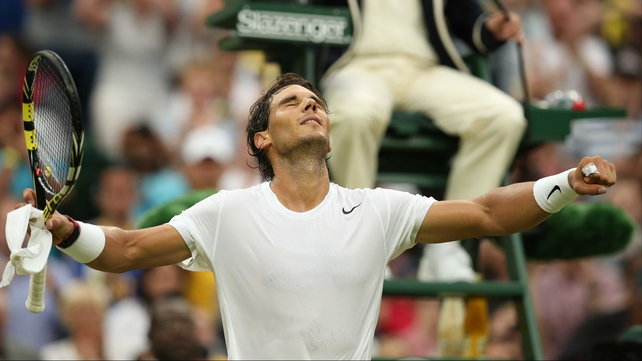 Nadal looks to the heavens after victory