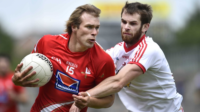 Tyrone's Ronan McNamee (r) and Louth's Conor Grimes