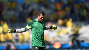 Brazil goalkeeper Julio Cesar warmed up prior to the opening whistle...