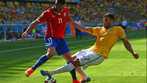 Chile forward Eduardo Vargas pushed ahead to force his side's hand with a bit of urgency, battling against Hulk along the way