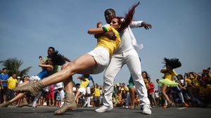 A crowd of spectators at the Copacabana in Rio couldn't help but dance throughout it all