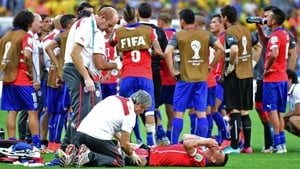 Before play resumed, Medel - who seemed in a great deal of pain - received some medical attention on the sidelines